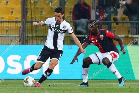 Parma's  Roberto Inglese  (L) and Genoa's Cristian Zapata (R) in action during the Italian Serie A soccer match Parma Calcio vs Genoa CFC at Ennio Tardini stadium in Parma, Italy, 20 October 2019.