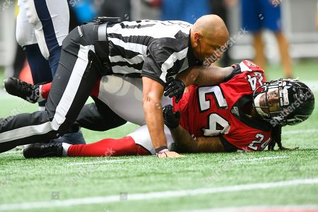 Referee Terry McAulay (77) breaks up an altercation between Atlanta Falcons running back Devonta Freeman (24) and Los Angeles Rams defensive tackle Aaron Donald during the second half of an NFL football game, in Atlanta