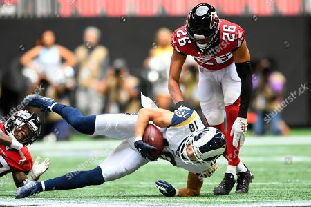 Los Angeles Rams wide receiver Cooper Kupp (18) makes the catch ahead of Atlanta Falcons cornerback Isaiah Oliver (26) during the first half of an NFL football game, in Atlanta