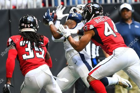 Stock Picture of Los Angeles Rams running back Todd Gurley (30) makes a touchdown catch against Atlanta Falcons' Vic Beasley (44) and Jamal Carter (35) during the first half of an NFL football game, in Atlanta