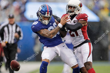 Stock Picture of New York Giants' Evan Engram, left, is defended by Arizona Cardinals' Patrick Peterson during the first half of an NFL football game, in East Rutherford, N.J