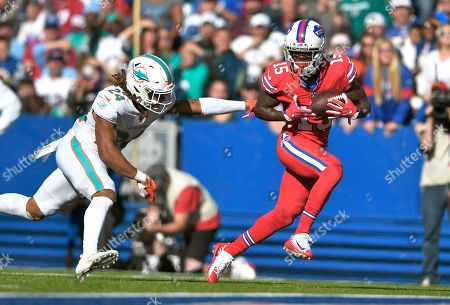 Stock Image of Buffalo Bills wide receiver John Brown, right, catches a pass in front of Miami Dolphins cornerback Ryan Lewis for a touchdown in the second half of an NFL football game, in Orchard Park, N.Y