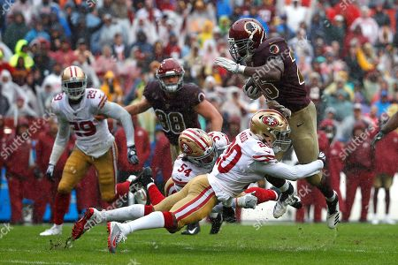 Week 13. Washington Redskins running back Adrian Peterson, right, rushes against San Francisco 49ers cornerback Jimmie Ward (20) in the first half of an NFL football game, in Landover, Md
