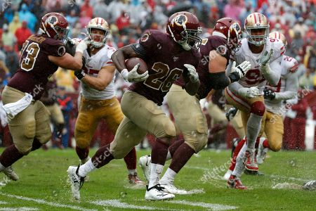 Week 13. Washington Redskins running back Adrian Peterson (26) rushes the ball in the second half of an NFL football game against the San Francisco 49ers, in Landover, Md