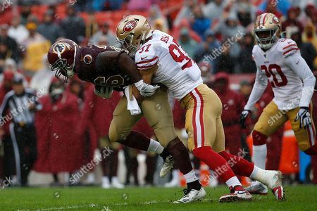 Week 13. San Francisco 49ers defensive end Nick Bosa, right, tackles Washington Redskins running back Adrian Peterson in the first half of an NFL football game, in Landover, Md