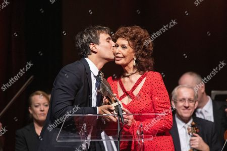 Italian actress Sophia Loren (R) is kissed by her son Carlo Ponti Jr. on stage after receiving the European Cultural Award Taurus for her lifetime achievements  during the European Cultural Award Gala in Vienna, Austria, 20 October 2019.
