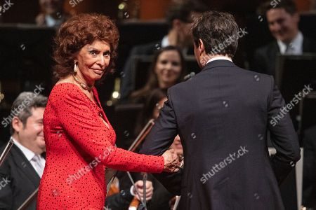 Italian actress Sophia Loren (L) leaves the stage after receiving the European Cultural Award Taurus for her lifetime achievements from her son Carlo Ponti Jr. during the European Cultural Award Gala in Vienna, Austria, 20 October 2019.