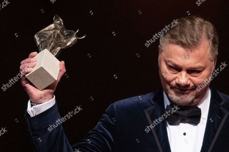 German bass Rene Pape stands on stage after receiving the European Cultural Award Taurus for music during the European Cultural Award Gala in Vienna, Austria, 20 October 2019.