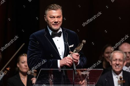 Stock Picture of German bass Rene Pape stands on stage after receiving the European Cultural Award Taurus for music during the European Cultural Award Gala in Vienna, Austria, 20 October 2019.