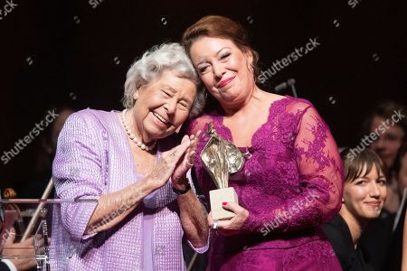 Stock Picture of Swedish opera singer Nina Stemme (R) poses with German opera singer Christa Ludwig on stage after receiving the European Cultural Award Taurus for music during during the European Cultural Award Gala in Vienna, Austria, 20 October 2019.