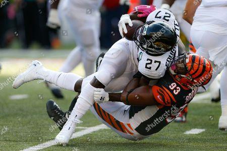 Cincinnati Bengals defensive tackle Andrew Brown (93) tackles Jacksonville Jaguars running back Leonard Fournette (27) in the second half of an NFL football game, in Cincinnati