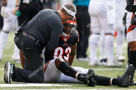 Cincinnati Bengals defensive tackle Andrew Brown (93) sits on the field with an apparent injury in the second half of an NFL football game against the Jacksonville Jaguars, in Cincinnati