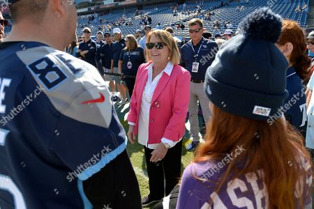 Tennessee Titans owner Amy Adams Strunk greets fans before an NFL football game between the Titans and the Los Angeles Chargers, in Nashville, Tenn