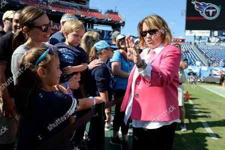 Tennessee Titans owner Amy Adams Strunk, right, greets fans before an NFL football game between the Titans and the Los Angeles Chargers, in Nashville, Tenn