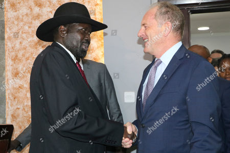 South Sudan's President Salva Kiir, left, shakes hands with U.N. chief, David Shearer, right, during meetings with the U.N. Security Council, about the status of the country's peace deal. Machar made an impassioned plea to a visiting United Nations Security Council delegation that met with him and President Salva Kiir to urge speedier progress in pulling the country out of a five-year civil war