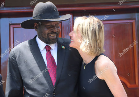 South Sudan's President Salva Kiir, left, and U.S. Ambassador to the U.N. Kelly Craft react as they talk, Sunday, Oct.20, 2019, while posing for pictures with the rest of the U.N. Security Council during the group's one-day visit to the capital Juba on Sunday to discuss the country's peace deal. Machar made an impassioned plea to a visiting United Nations Security Council delegation that met with him and President Salva Kiir to urge speedier progress in pulling the country out of a five-year civil war