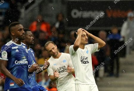 Marseille's Saif-Eddine Khaoui, right, reacts after missing a chance to score during the French League One soccer match between Marseille and Strasbourg at the Velodrome stadium in Marseille, southern France