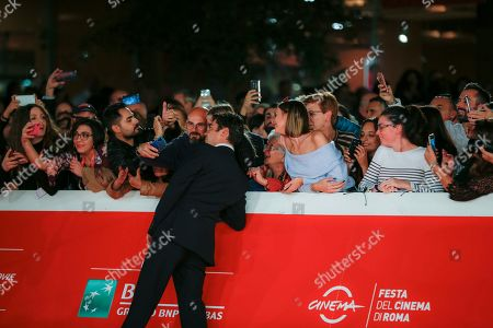 Actor Riccardo Scamarcio arrives on the red carpet for the screening of 'Il ladro di giorni' at the Rome Film Fest in Rome