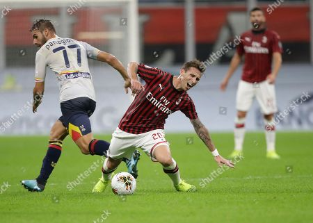 AC Milan's Lucas Biglia, right, is tackled by Lecce's Panagiotis Tachtsidis during Serie A soccer match between AC Milan and Lecce, at the San Siro stadium in Milan, Italy, Sunday, Oct.20, 2019