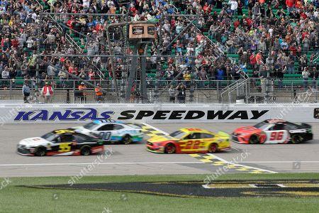 Matt DiBenedetto, Landon Cassill, Joey Logano, Parker Kligerman. Matt DiBenedetto (95), Landon Cassill (00), Joey Logano (22) and Parker Kligerman (96) take the green flag during a NASCAR Cup Series auto race at Kansas Speedway in Kansas City, Kan
