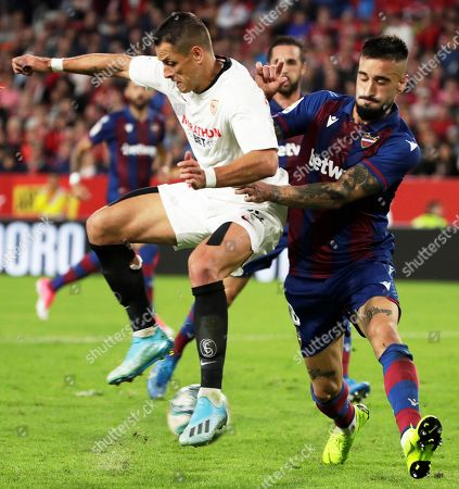 Stock Picture of Sevilla's Javier Hernandez 'Chicharito' (L) in action against Levante's Erick Cabaco (R) during the Spanish La Liga soccer match between Sevilla FC and Levante UD at Sanchez Pizjuan stadium in Seville, southern Spain, 20 October 2019.