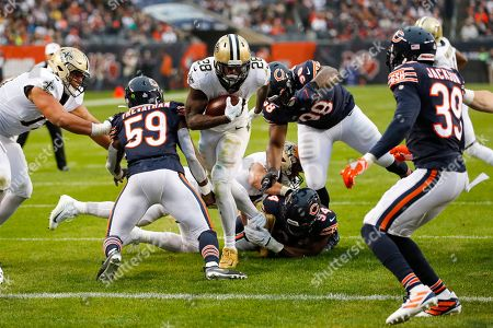 New Orleans Saints running back Latavius Murray (28) dives in for a touchdown between Chicago Bears inside linebacker Danny Trevathan (59) and free safety Eddie Jackson (39) during the second half of an NFL football game in Chicago