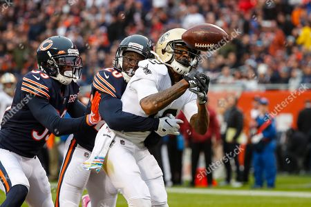 New Orleans Saints wide receiver Ted Ginn (19) drop a pass in the end zone as he's hit by Chicago Bears cornerback Prince Amukamara (20) during the first half of an NFL football game in Chicago