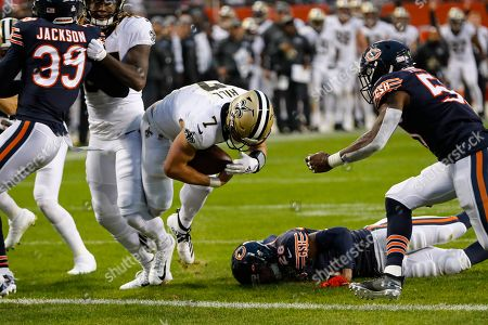 New Orleans Saints quarterback Taysom Hill (7) dives in for a touchdown in front of Chicago Bears inside linebacker Danny Trevathan (59) during the second half of an NFL football game in Chicago