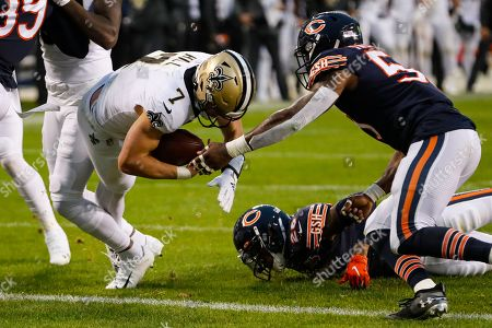 New Orleans Saints quarterback Taysom Hill (7) drives in for a touchdown in front of Chicago Bears inside linebacker Danny Trevathan (59) during the second half of an NFL football game in Chicago