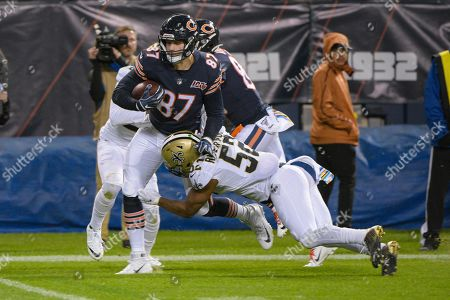 Chicago Bears tight end Adam Shaheen (87) its tackled by New Orleans Saints linebacker Craig Robertson (52) during the second half of an NFL football game in Chicago