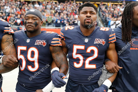 The Chicago Bears' Danny Trevathan (59) and Khalil Mack link arms during the national anthem before an NFL football game against the New Orleans Saints in Chicago