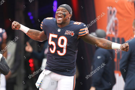 Chicago Bears inside linebacker Danny Trevathan reacts as he is introduced before an NFL football game against the New Orleans Saints in Chicago