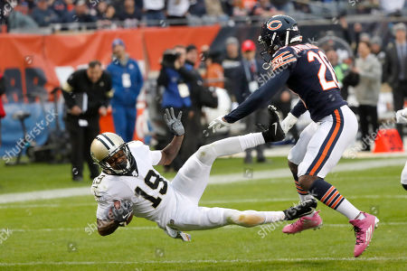 New Orleans Saints wide receiver Ted Ginn (19) makes a reception as Chicago Bears cornerback Prince Amukamara defends during the first half of an NFL football game against the Chicago Bears in Chicago