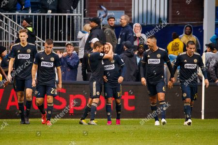 Philadelphia Union's Marco Fabian (10) celebrates his goal with teammates during extra time of an MLS soccer Eastern Conference first-round playoff match against the New York Red Bulls, in Chester, Pa
