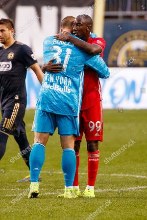 New York Red Bulls' Bradley Wright-Phillips, right, gives Luis Robles, left, a hug following extra time of an MLS soccer Eastern Conference first-round playoff match against the Philadelphia Union, in Chester, Pa