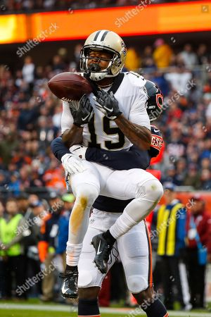 Prince Amukamara, Ted Ginn. New Orleans Saints wide receiver Ted Ginn (19) drops a pass in the end zone as he's hit by Chicago Bears cornerback Prince Amukamara (20) during the first half of an NFL football game in Chicago
