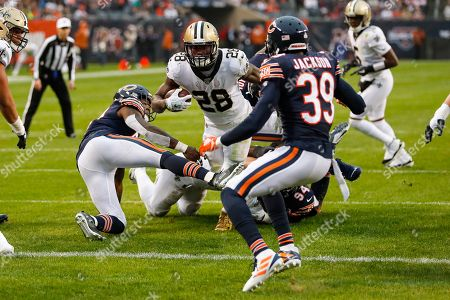 Latavius Murray, Eddie Jackson, Danny Trevathan. New Orleans Saints running back Latavius Murray (28) dives in for a touchdown between Chicago Bears inside linebacker Danny Trevathan (59) and free safety Eddie Jackson (39) during the second half of an NFL football game in Chicago