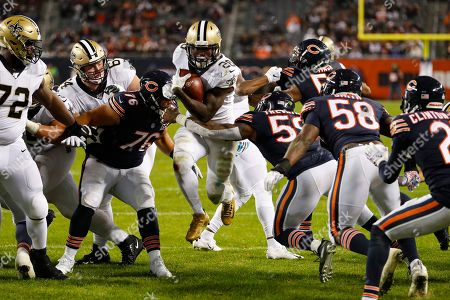 Danny Trevathan, Abdullah Anderson, Latavius Murray. New Orleans Saints running back Latavius Murray (28) runs in for a touchdown between Chicago Bears defensive tackle Abdullah Anderson (76) and inside linebacker Danny Trevathan (59) during the second half of an NFL football game in Chicago