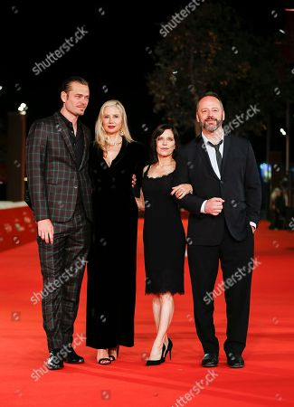 Christopher Backus, Mira Sorvino, Melora Walters, Gill Bellows. From left, actors Christopher Backus, Mira Sorvino, director Melora Walters, and actor Gill Bellows arrive on the red carpet for the screening of 'Drowning' at the Rome Film Fest in Rome