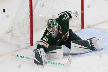 Minnesota Wild's Devan Dubnyk (4)0 blocks the puck from the net in the third period of an NHL hockey game against the Montreal Canadiens, in St. Paul, Minn
