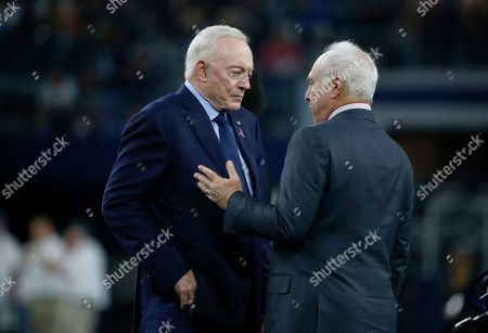 Jerry Jones, Jeffrey Lurie. Dallas Cowboys team owner Jerry Jones, and Philadelphia Eagles owner Jeffrey Lurie, right, talk on the field before an NFL football game in Arlington, Texas