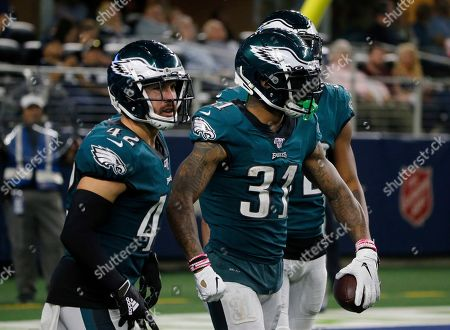 Jalen Mills, Andrew Sendejo. Philadelphia Eagles' Andrew Sendejo (42) and Jalen Mills (31) celebrate a interception by Mills in the second half of an NFL football game against the Dallas Cowboys in Arlington, Texas