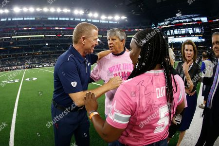 Dallas Cowboys head coach Jason Garrett meets fans on the sidelines before a game between the Philadelphia Eagles and Dallas Cowboys in an NFL football game in Arlington, Texas