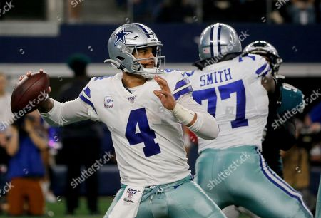 Dak Prescott, Tyron Smith. Dallas Cowboys quarterback Dak Prescott (4) throws a pass as offensive tackle Tyron Smith (77) provides protection in the first half of an NFL football game agains the Philadelphia Eagles in Arlington, Texas, Sunday