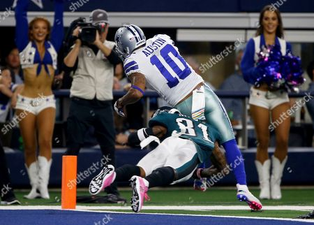Jalen Mills, Tavon Austin. Dallas Cowboys wide receiver Tavon Austin (10) reaches the end zone over Philadelphia Eagles' Jalen Mills (31) for a touchdown in the first half of an NFL football game in Arlington, Texas