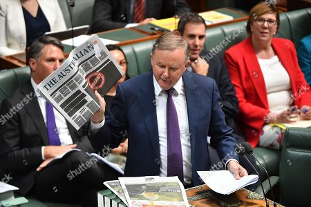 Australian opposition leader Anthony Albanese (C) holds up a newspaper featuring a 'Your Right to Know' campaign illustration durring Question Time in the House of Representatives at Parliament House in Canberra, Australia, 21 October 2019. The front pages of some major newspapers on 21 October replicated a heavily redacted government document, alongside an advertising campaign challenging laws that effectively criminalize journalism and whistleblowing.