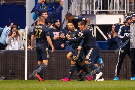 Philadelphia Union's Marco Fabian (10) celebrates his goal with teammates during extra time of an MLS soccer Eastern Conference first-round playoff match, in Chester, Pa. The Union won 4-3 in extra time