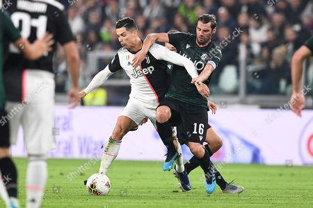 Cristiano Ronaldo of Juventus and Andrea Poli of Bologna