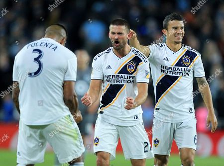 LA Galaxy's Diego Polenta (3), Giancarlo Gonzalez (21) and Servando Carrasco celebrate after defeating Minnesota United during an MLS first-round playoff soccer match, in St. Paul, Minn. The Galaxy won 2-1
