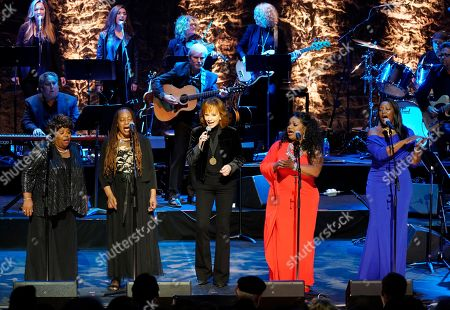 Reba McEntire, The McCrary Sisters. Reba McEntire, middle, performs with The McCrary Sisters during the 2019 Medallion Ceremony at the Country Music Hall of Fame and Museum on in Nashville, Tenn